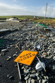 The main road in Kilbaha village covered by rocks, undermined in places and cut off following the latest high seas and gales at Kilbaha. Photograph by John Kelly.