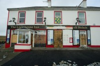 A view of the boarded up Lighthouse Inn in Kilbaha village where the sea and storm caused damage to the road through the West Clare village. Photograph by John Kelly.