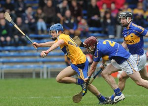 Shane O Donnell of Clare has his togs tested by Paddy Stapleton of Tipperary during their National League game at Thurles. Photograph by John Kelly.