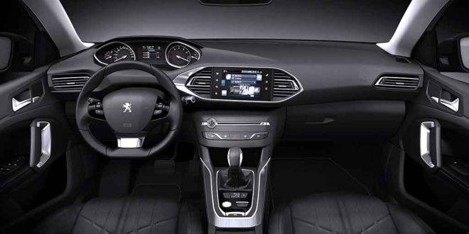 The interior of the Peugeot 308 SW showing the touch screen which controls most functions.