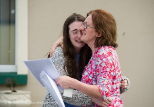 Susie Fogarty, a pupil of Gaelcholaiste an Chlair, has tears of joy as she embraces her mother Bridget while collecting her Leaving cert  results on Wednesday morning. Photograph by John Kelly.