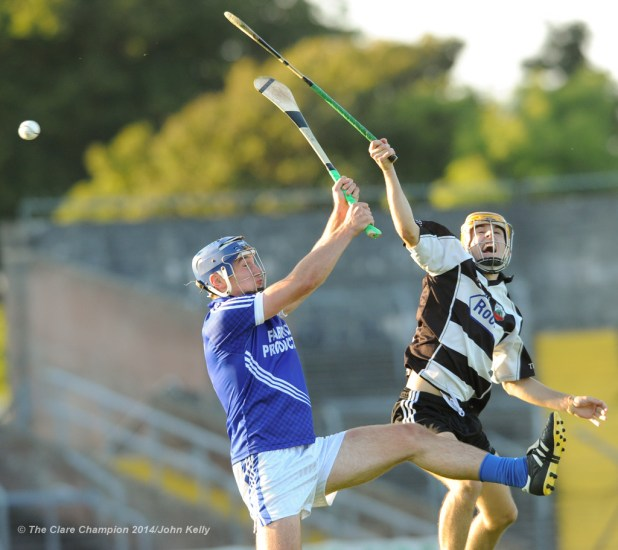 Conor Ryan of Cratloe in action against Stephen Ward of Clarecastle during their semi-final at Cusack Park. Photograph by John Kelly.