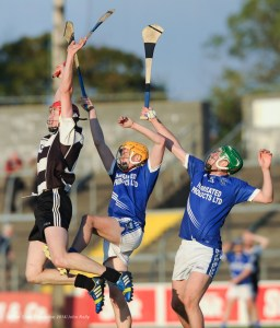 Patrick Kelly of Clarecastle in action against David Collins and Cathal Mc Inerney of Cratloe during their semi-final at Cusack Park. Photograph by John Kelly.