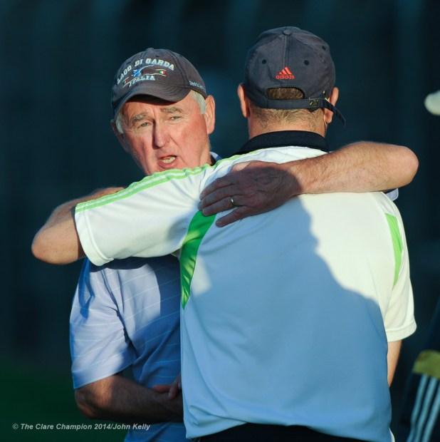 Cratloe manager Joe Mc Grath and Clarecastle coach Fergus O Loughlin embrace after their semi-final at Cusack Park. Photograph by John Kelly.