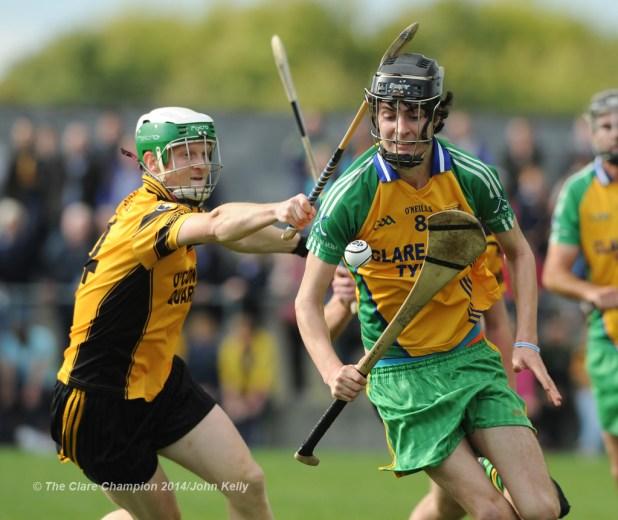 Ronan Carey of Clonlara in action against Shane Mc Inerney of Inagh-Kilnamona during their Junior A final at Clarecastle. Photograph by John Kelly.