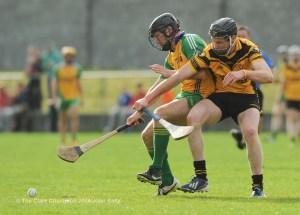 Jimmy Carmody of Inagh-Kilnamona in action against Patrick Conlon of Clonlara during their Junior A final at Clarecastle. Photograph by John Kelly.
