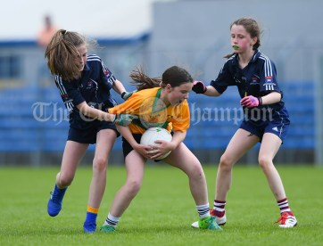 Maeve Barry of Knockanean NS in action against Ciara Frawley and Lucy Power of Barefield NS during their Division 1 LGFA Ladies Football Primary Schools final at Cusack park. Photograph by John Kelly