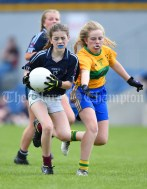 Katie Hardiman of Barefield NS in action against Amy Butler of Knockanean NS during their Division 1 LGFA Ladies Football Primary Schools final at Cusack park. Photograph by John Kelly