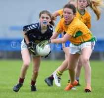 Katie Hardiman of Barefield NS in action against Lauren Quinn of Knockanean NS during their Division 1 LGFA Ladies Football Primary Schools final at Cusack park. Photograph by John Kelly