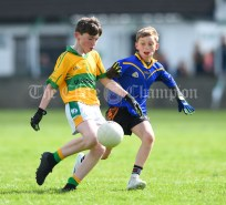 Brian Keane of Carrigaholt/Moveen in action against Lucca Mullins of Carron/New Quay,Ballyvaughan/Fanore during their Primary Schools Div 3 Football 11-Aside final at Kilrush. Photograph by John Kelly