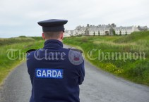 A Garda on patrol outside Trump International Golf Club at Doonbeg as preparations continue for the visit of the United States President. Photograph by John Kelly
