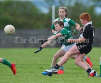 James Blunnie of Kilrush in action against Darragh O Sullivan of Doonbeg during their Primary Schools Div 2 Football 13-Aside final at Kilrush. Photograph by John Kelly