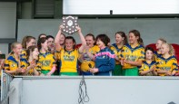 Rhea Foudy of Inagh/Cloonanaha lifts the trophy following their Schools Division 1 final at Cusack Park. Photograph by John Kelly