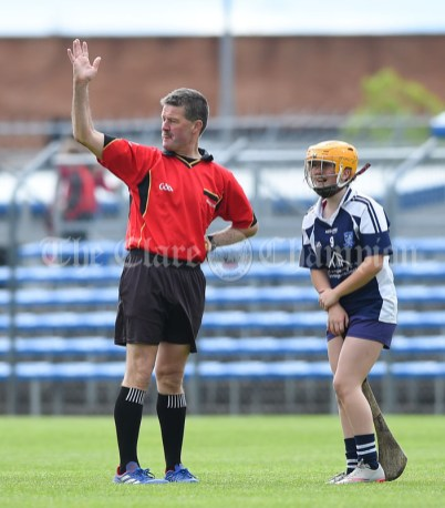 Referee Jim Hickey calls for assistance for an injured Rachel Guerin of Bridgetown during their Munster Championship game at Walsh Park. Photograph by John Kelly