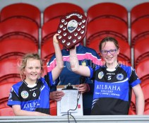 Kilkee/Kilbaha joint captains Susan Mc Grath and Aine Bonfil collect the trophy following their Munster Championship game at Walsh Park. Photograph by John Kelly