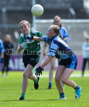 Sarah Mc Anespie of St Senan's Kilrush in action against Aimee Mc Namara of Cooraclare/Cree/Clohanbeg during their Division 2 LGFA Ladies Football Primary Schools final at Cusack park. Photograph by John Kelly