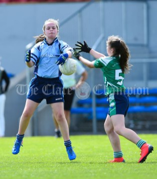 Karine O Leary of Cooraclare/Cree/Clohanbeg in action against Grace Mc Inerney of St Senan's Kilrush during their Division 2 LGFA Ladies Football Primary Schools final at Cusack park. Photograph by John Kelly