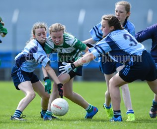 Sarah Blunnie of St Senan's Kilrush in action against Aisling Kelly and Marian Lynch of Cooraclare/Cree/Clohanbeg during their Division 2 LGFA Ladies Football Primary Schools final at Cusack park. Photograph by John Kelly