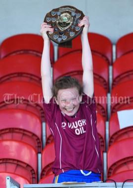 Tara Connolly of Lisdoonvarna Parish Schools lifts the trophy following their win over Scoil Realt Na Mara, Kilkee/Moyasta NS in their Division 3 LGFA Ladies Football Primary Schools final at Cusack park. Photograph by John Kelly