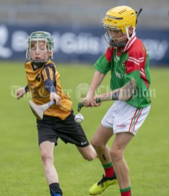 120619 Clooneys Cathal Leamy under pressure from Clonmoneys Jack McNamara during the Division 4 Hurling Clare Primary School Finals .Pic Arthur Ellis