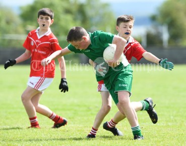 Niall Twomey of Rineen in action against Dylan O Neill of Kilmurry Mc Mahon/Labasheeda during their Primary Schools Div 4 Football 9-Aside final at Kilrush. Photograph by John Kelly