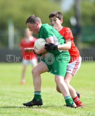 Niall Twomey of Rineen in action against Joseph Hehir of Kilmurry Mc Mahon/Labasheeda during their Primary Schools Div 4 Football 9-Aside final at Kilrush. Photograph by John Kelly
