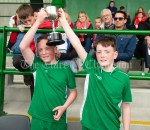 Twin captains Niall and Gavin Twomey of Rineen collect the cup following their Primary Schools Div 4 Football 9-Aside final at Kilrush. Photograph by John Kelly