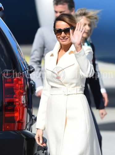 First Lady Melania Trump waves to the waiting media following her arrival with President of the United States Of America Donald J. Trump at Shannon. Photograph by John Kelly.