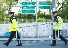Gardai moving barriers ahead of the walkabout by Eric and Don Junior Trump in Doonbeg Village. Photograph by John Kelly