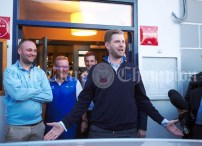 Eric Trump, Son of United States President Donald Trump, addresses the crowd gathered as he arrives outside Morrissey's in Doonbeg Village. Looking on are Scott Marr, Head Green-keeper, Brian Shaw, Head Professional at Doonbeg Golf Club and Hugh Mc Nally of Morrissey's at rear. Photograph by John Kelly.