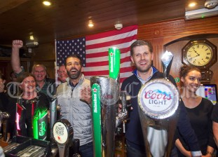 Don Junior and Eric Trump take on barman duties and fill drinks for thirsty punters in Tubridy's Bar during their walkabout in Doonbeg Village. Photograph by John Kelly