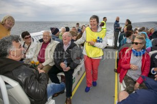 230819 Teresa Conlon, Ennis, keeps the drinks flowing during the RNLI fund raising cruise to the Cliffs of Moher and Inis Oir with Doolin2Aran Ferries Star of Doolin on Friday evening.Pic Arthur Ellis.