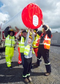 The Glenmore Windfarm Group get to grips with a windmill tower during the Cultural Parade as part of the annual Festival Of Fun in Kilmihil. Photograph by John Kelly