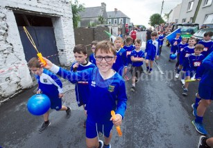 Local young soccer players taking part in the Cultural Parade as part of the annual Festival Of Fun in Kilmihil. Photograph by John Kelly