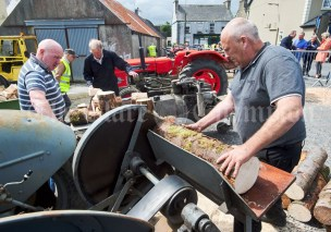 Kieran Quinn of Sixmilebridge demonstrating a tractor mounted circular saw during the Vintage Rally and field day as part of the annual Festival Of Fun in Kilmihil. Photograph by John Kelly