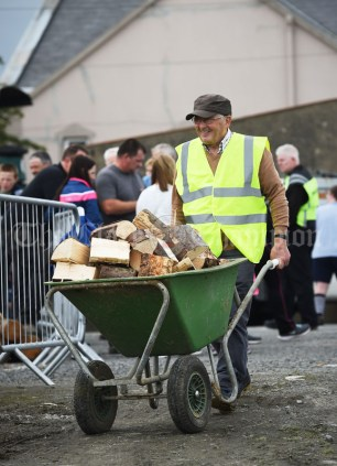 Gregory Fitzgerald demonstrates the removal of split logs during the Vintage Rally and field day as part of the annual Festival Of Fun in Kilmihil. Photograph by John Kelly