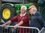 Michael Mc Inerney of Kilmihil and Joe Hughes of Shyan look on at a wood cutting demonstration during the Vintage Rally and field day as part of the annual Festival Of Fun in Kilmihil. Photograph by John Kelly
