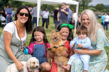 250819 L-R Tara Gleeson, Elsie Quinn (7), Holly Quinn (10), Jesse Galvin ( 10 months) and Leanne Galvin, Cratloe, with Remy and Lotte the dogs at Kilmurry Festival Field Day on Sunday.Pic Arthur Ellis.