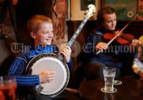 Cian Corry playing in a sessiun in Buggles as part of the Kilrush Traditional Music & Set Dancing Festival. Photograph by John Kelly