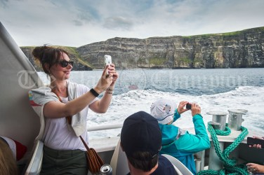 Emma Cullen capturing the beauty of the Cliffs Of Moher during the Romantic RNLI Cruise held in association with Bill O Brien's Doolin Ferry Company. Photograph by John Kelly