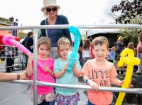 020819 Triplets Eabha, Rianna and Coen (4) from ogonnelloe with their nana Rosa Cracaterra at the Scariff harbour festival on Sunday.pic Arthur Ellis.