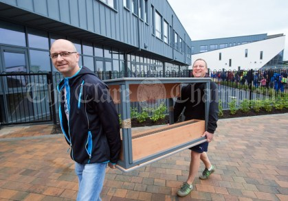 Doing Their Tables..Parents helping with a last minute furniture delivery during the first day of school at the newly built Ennis CBS primary school. Photograph by John Kelly