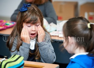 Third class pupil Faye Frawley feeling a little bit tired with all the excitement during the first day of school at the newly built Ennis CBS primary school. Photograph by John Kelly