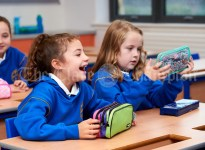 Keela Davis and Sorcha Farrelly compering pencil cases during the first day of school at the newly built Ennis CBS primary school. Photograph by John Kelly