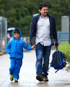 Siju Paul bring his junior infant son Nathan for his first day of school at the newly built Ennis CBS primary school. Photograph by John Kelly