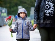 Junior infant Martus Bakarac, arrives with flowers for his teacher Mrs. Ryan, during the first day of school at the newly built Ennis CBS primary school. Photograph by John Kelly