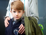 Junior infant Gearoid Tierney appears full of apprehension as he awaits to be shown his classroom during the first day of school at the newly built Ennis CBS primary school. Photograph by John Kelly