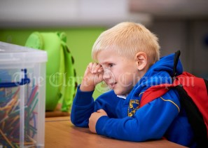 Junior Infant Leo Jakusz, feeling a little teary during the first day of school at the newly built Ennis CBS primary school. Photograph by John Kelly
