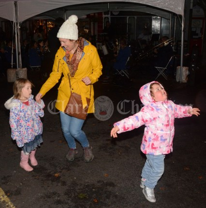 Eabha McNena and Faye Madigan dancing in Barrack Street with Ríonach McNena on Thursday night during the Clare Food and Drink Fleadh.