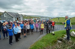 Joe Queally speaking to the crowd before the Burren Ramble in aid of the RNLI at Fanore. Photograph by John Kelly